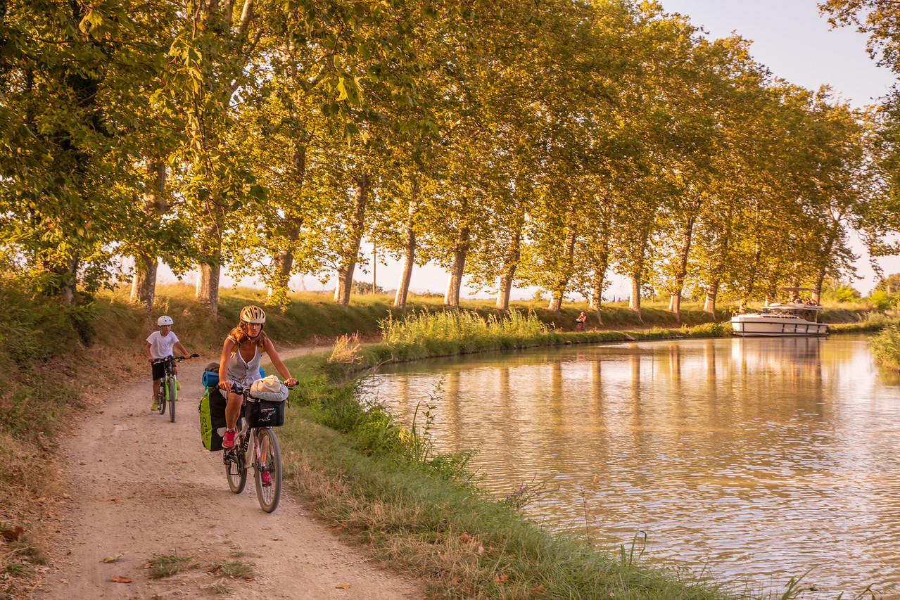 Bicyclists on the Canal du Midi Near Colombiers, France