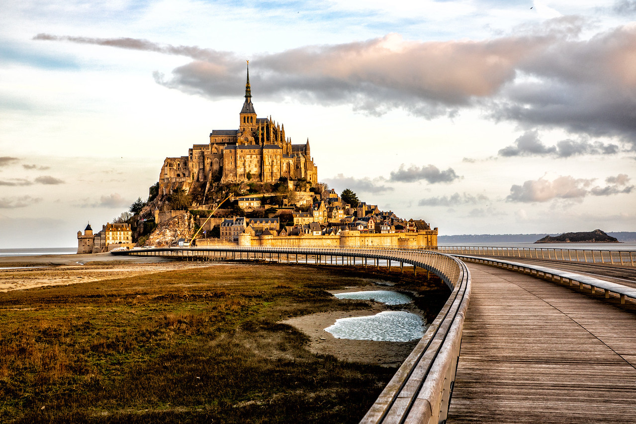 Photo of Sunrise at le mont st michel France at low tide