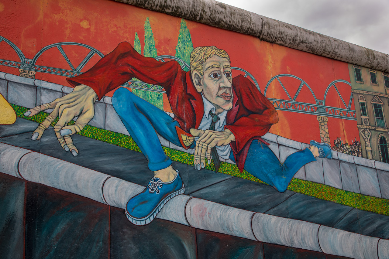 This Berlin Wall Graffiti Art, 'Der Mauerspringer', meaning the wall jumper, by Gabriel Heimler, at the East Side Gallery Berlin