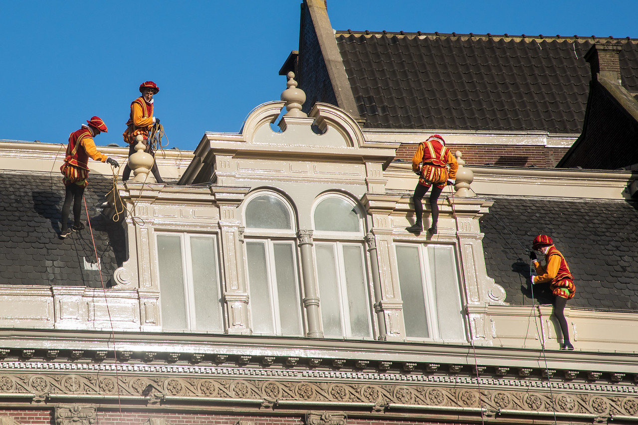 Zwarte Piet Climbing the Buildings of Amsterdam