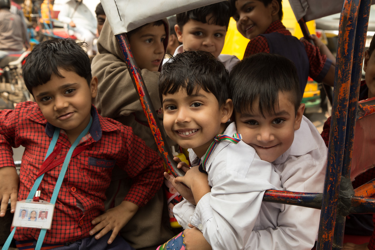 Picture of children playing in a pedicab in India