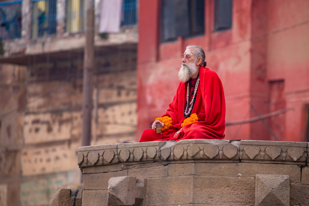 Image of a Sadhu Watching the Ganges River While Enjoying Morning Chai Tea