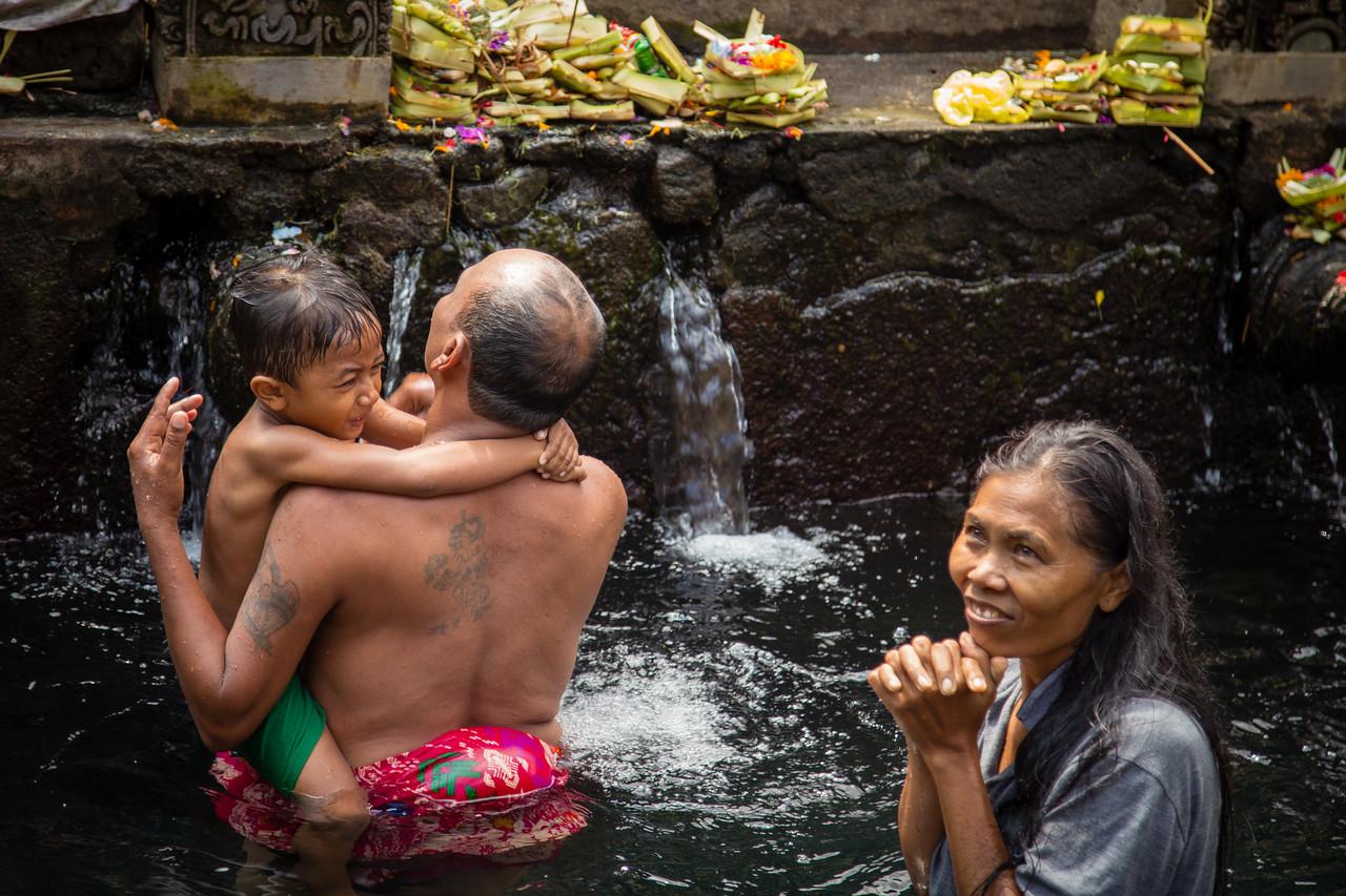 Devotees Bathing at Tirta Empul Holy Springs in Bali