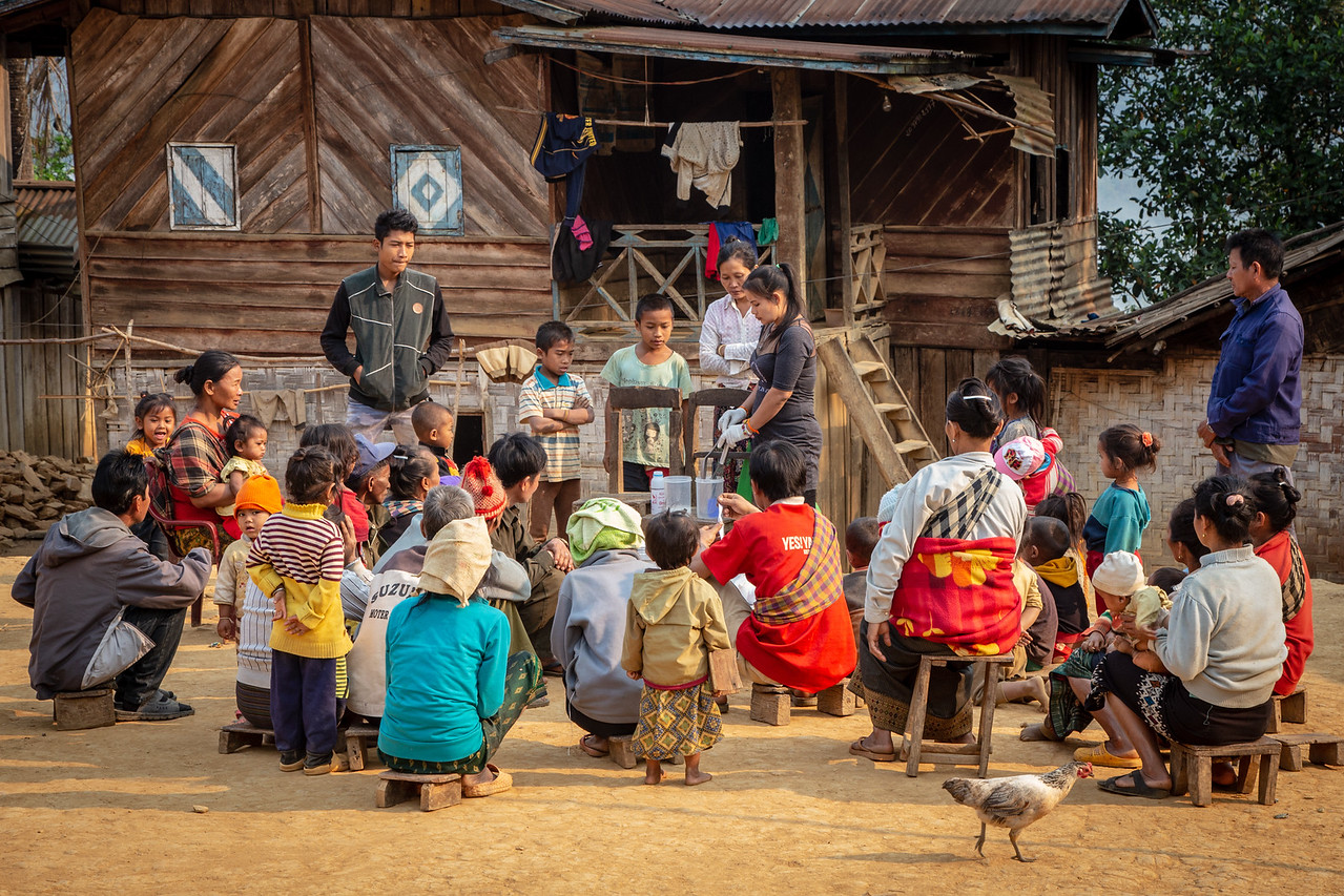 La Giving a Soap Making Demonstration in a Hill Tribe Village