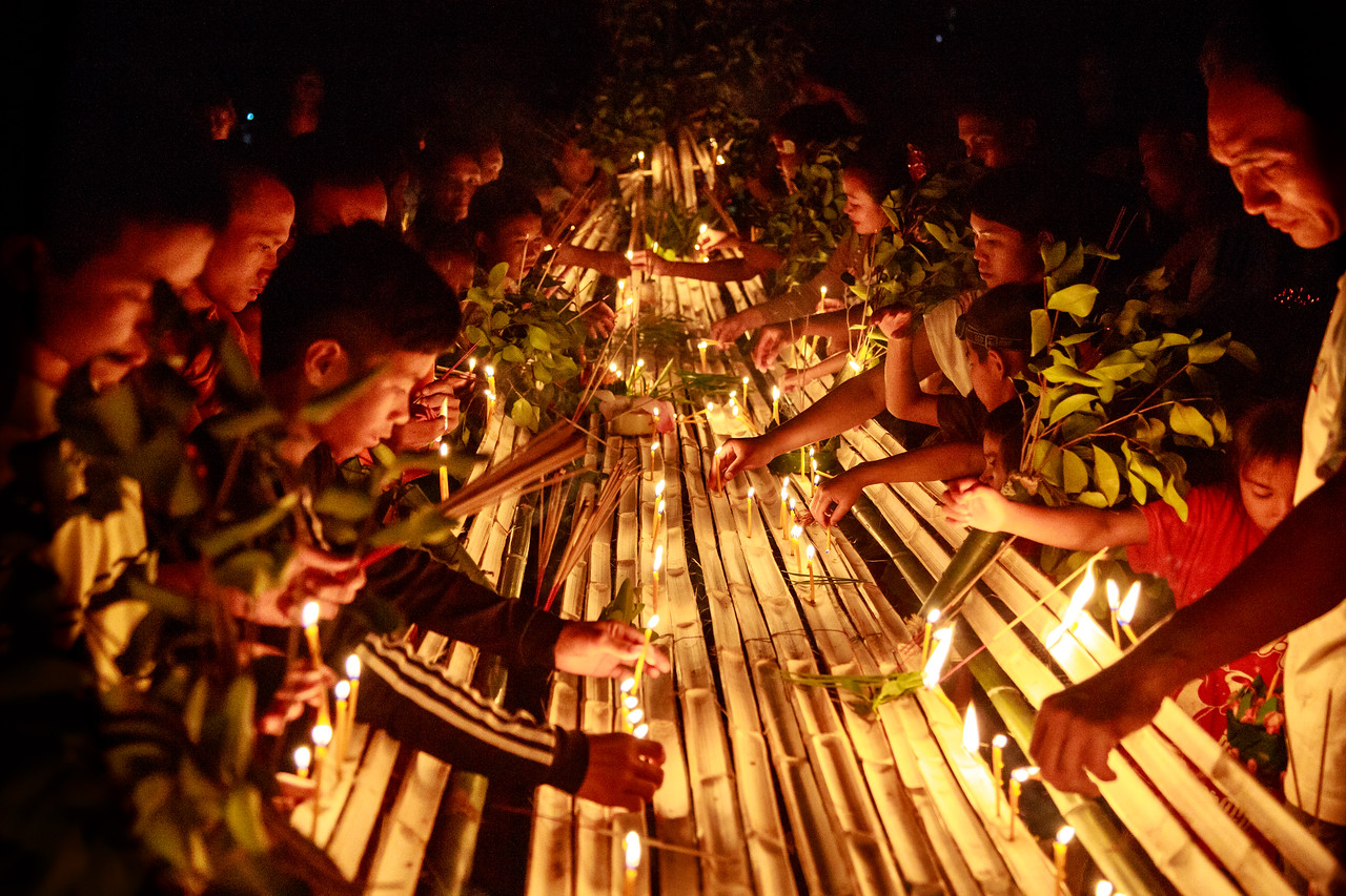 Adherents Placing Candles in the Bamboo Boat on Buddhist Lent