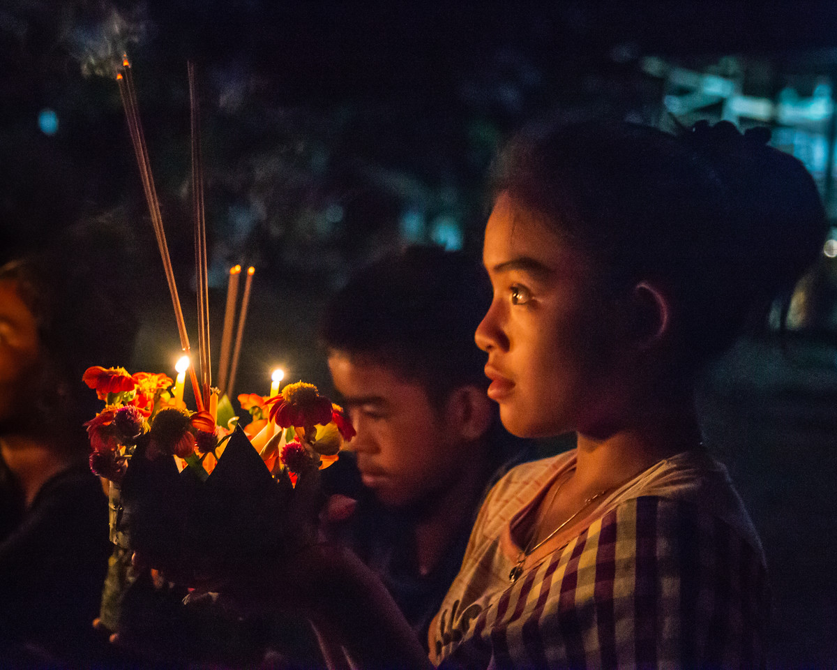 Young Girl Meditating on Her Krathong During Buddhist Lent