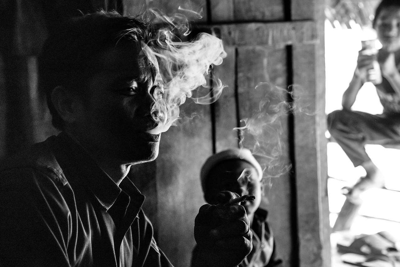 Photo: Smoking Man in Phongsaly Province, Laos