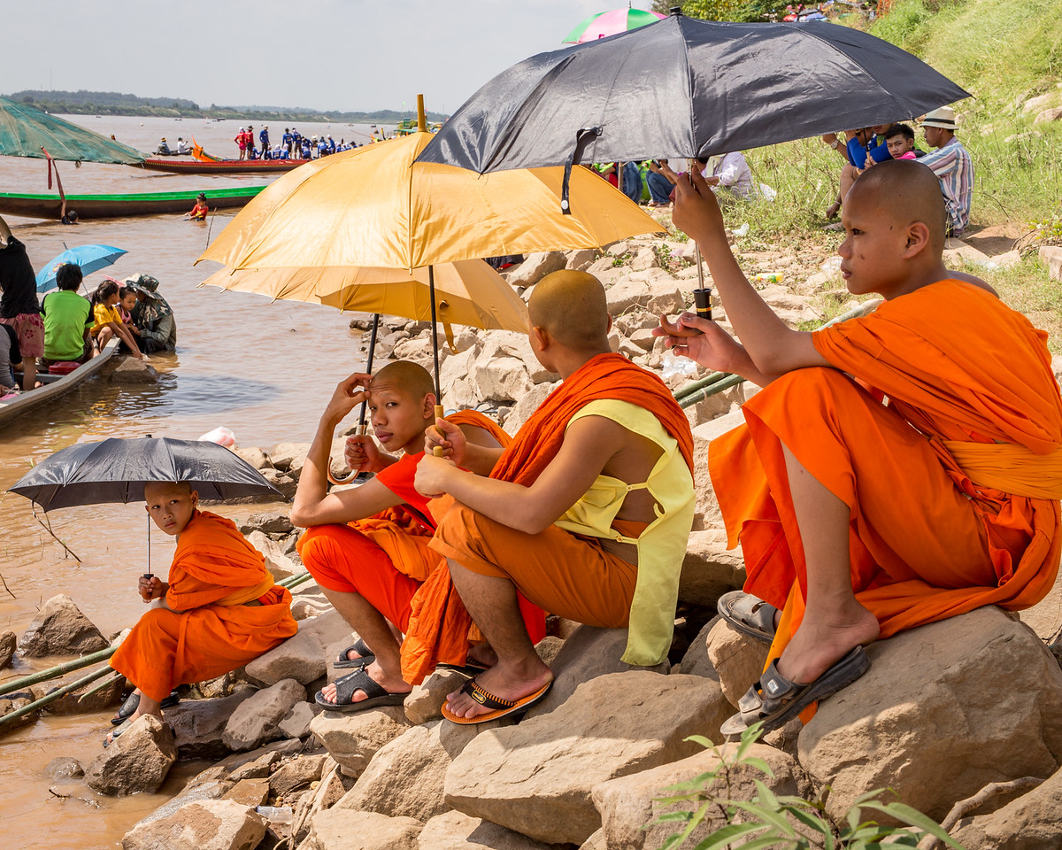 Photo: Monks on Mekong River Watching Dragon Boat Races