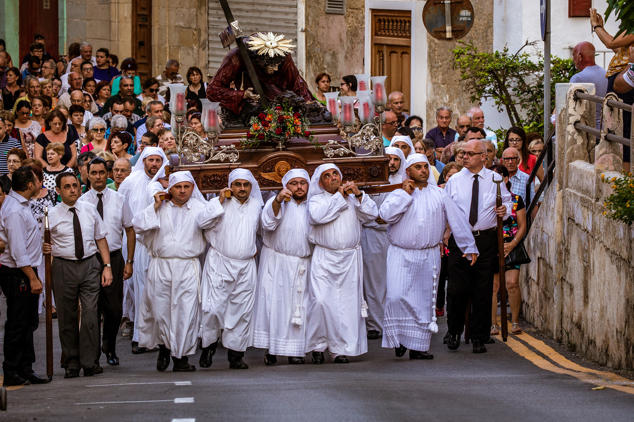 Adherents Carry Jesus the Redeemer During the Feast of VowsThrough Senglea in Malta