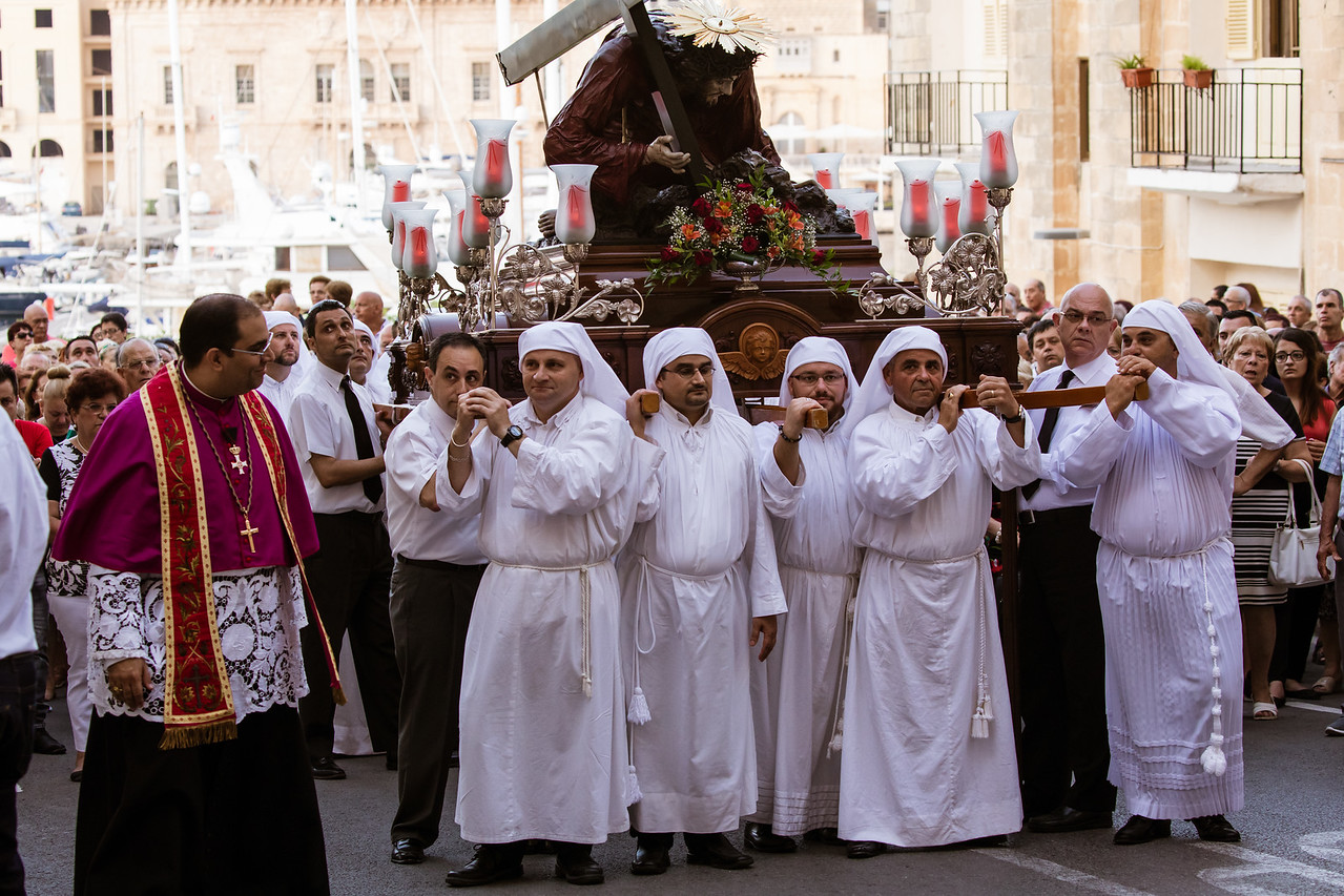 The Feast of Vows Religious Procession Stops At The Waterfront in Senglea, Malta