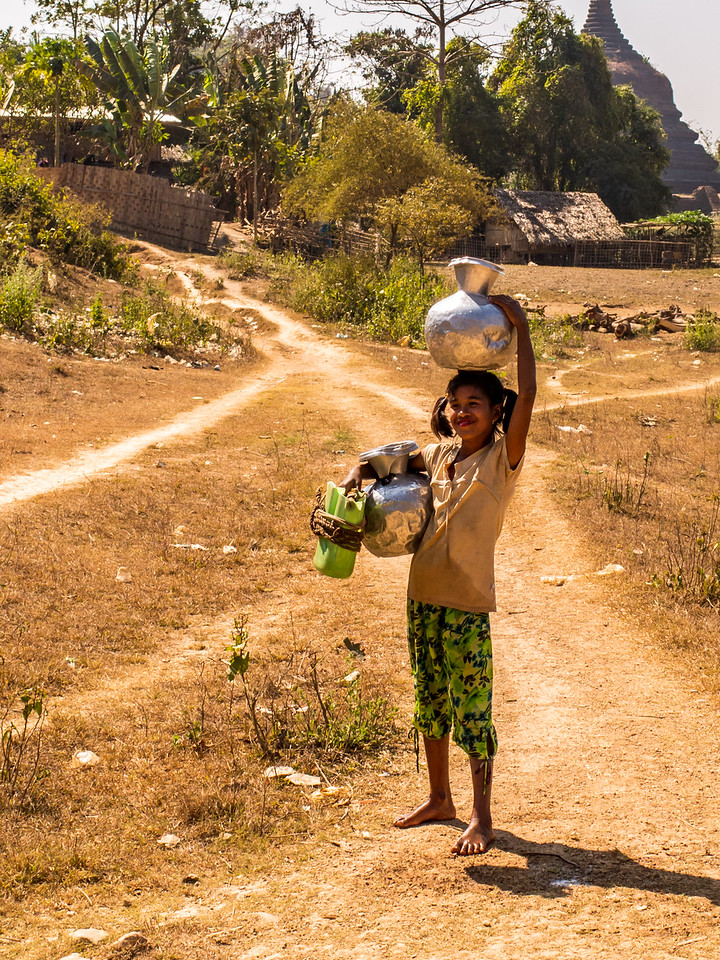 Girl Carrying Water in Mrauk OO, Myanmar
