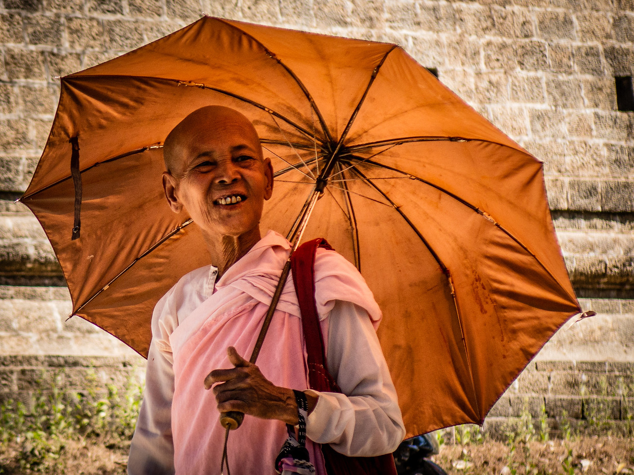 Buddhist Nun Walking Outside of a Temple in Mrauk U