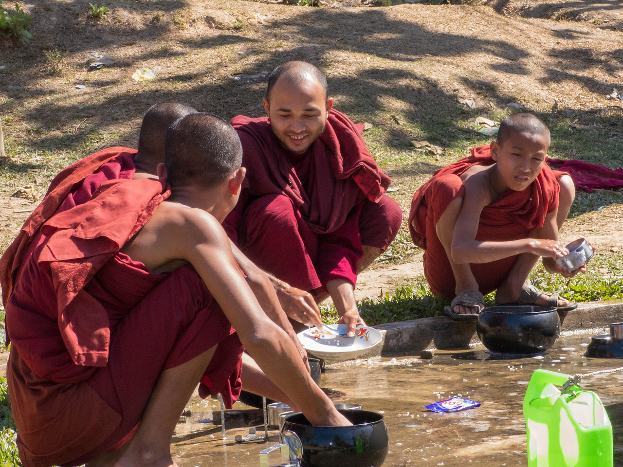 Monks Washing Dishes Outside of Andaw Temple