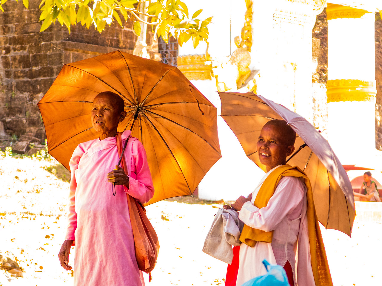 A Pair of Buddhist Nuns Walking Outside a Pagoda in Mrauk U
