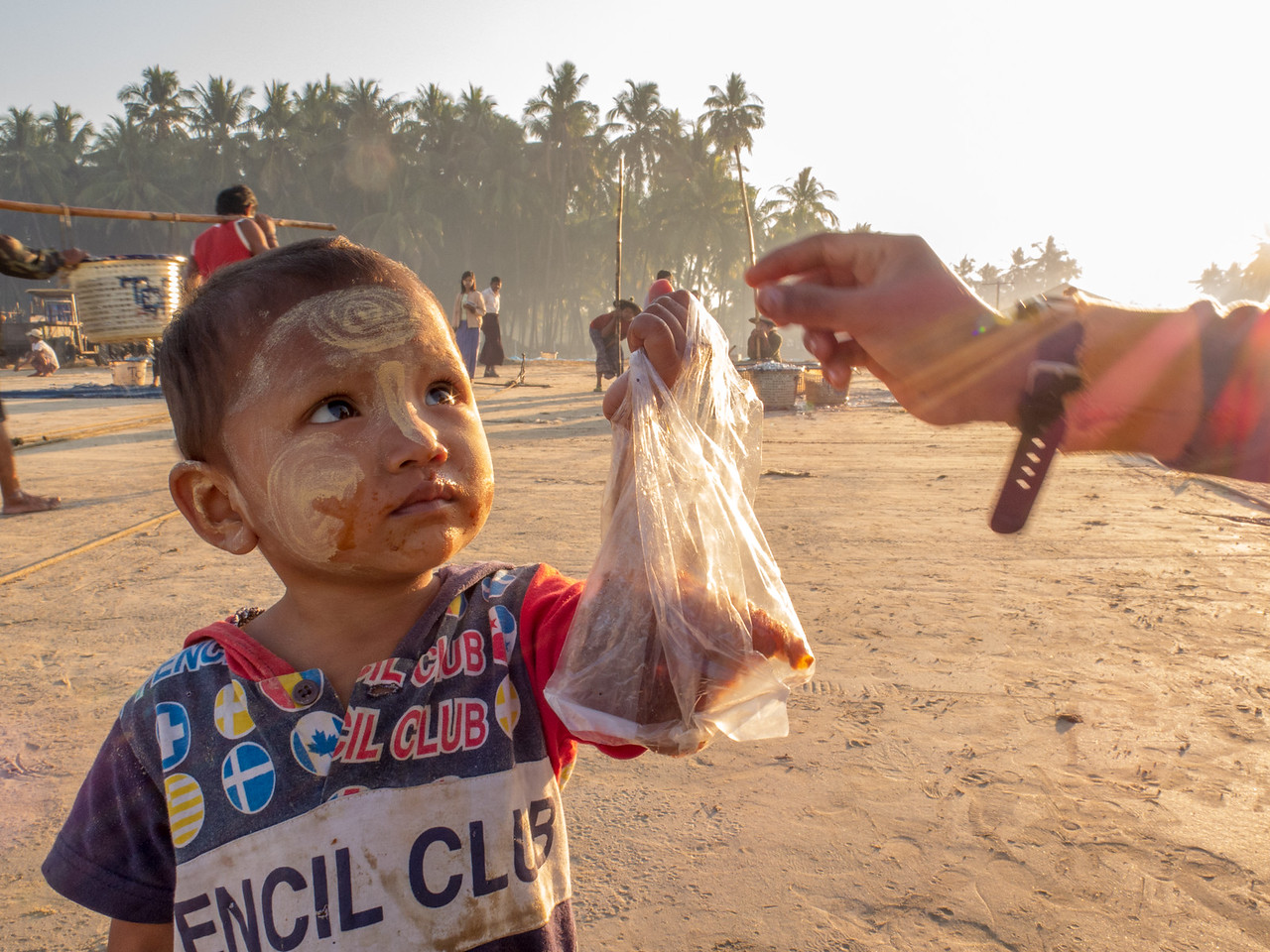 A Young Boy Brings Breakfast to His Myanmar Fisherman Father