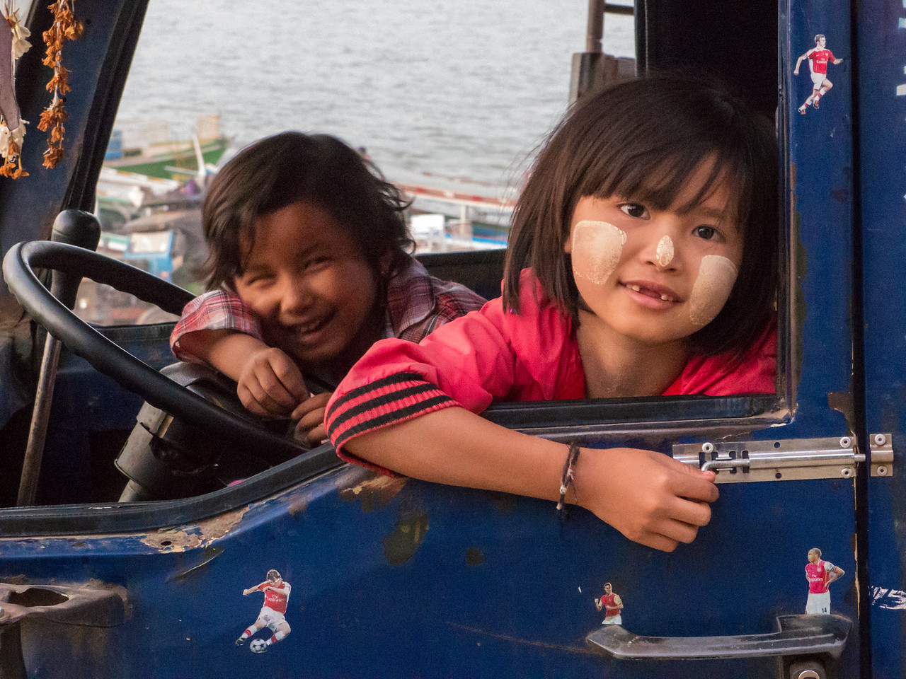 Kids Playing in a Delivery Truck near the Irrawaddy River, Myanmar