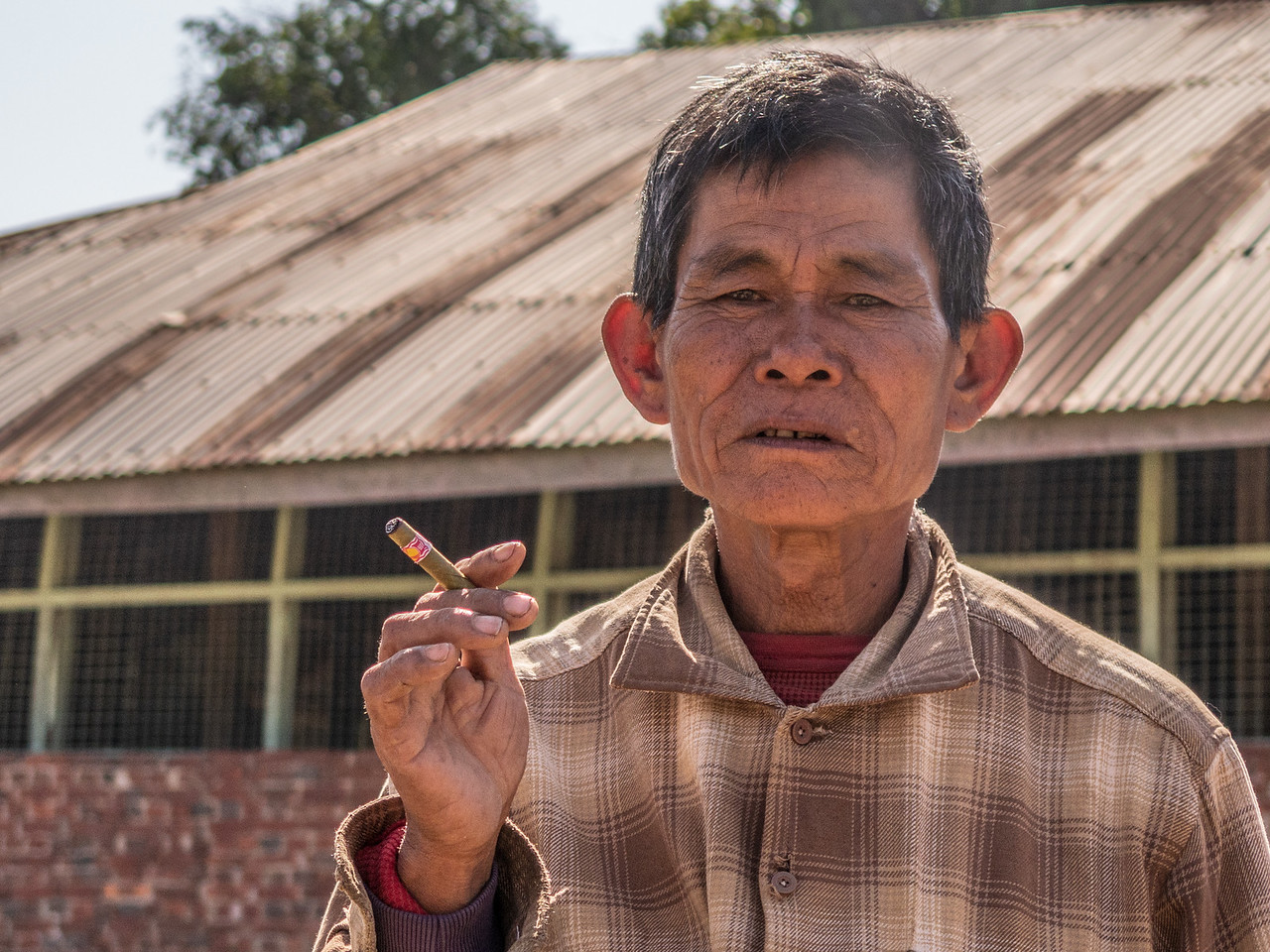 Burmese Man Poses with Cigar in Myanmar