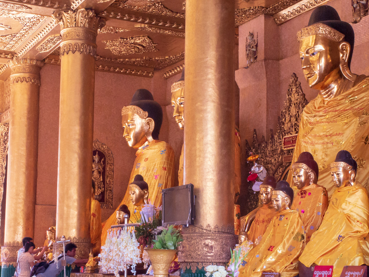Devotees Praying to Giant Buddha Images at Shwedagon Pagoda