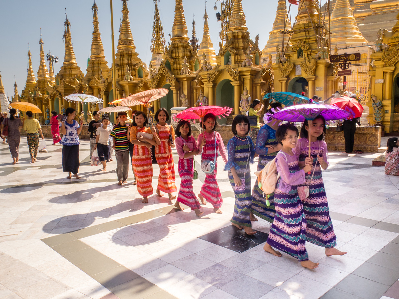 Devotees With Bright Umbrellas Circumambulating Shwedagon Pagoda