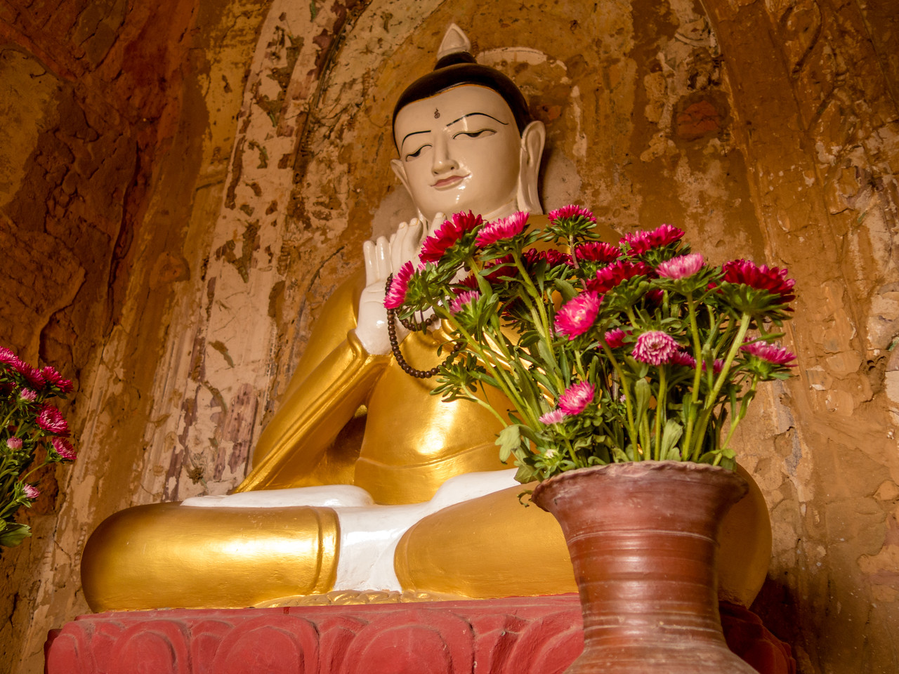 Buddha with Fresh Flowers in a Bagan Temple