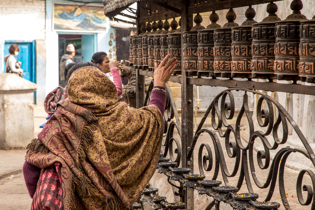 Woman Turning the Prayer Wheel at Swayambhunath Temple Kathmandu Photography