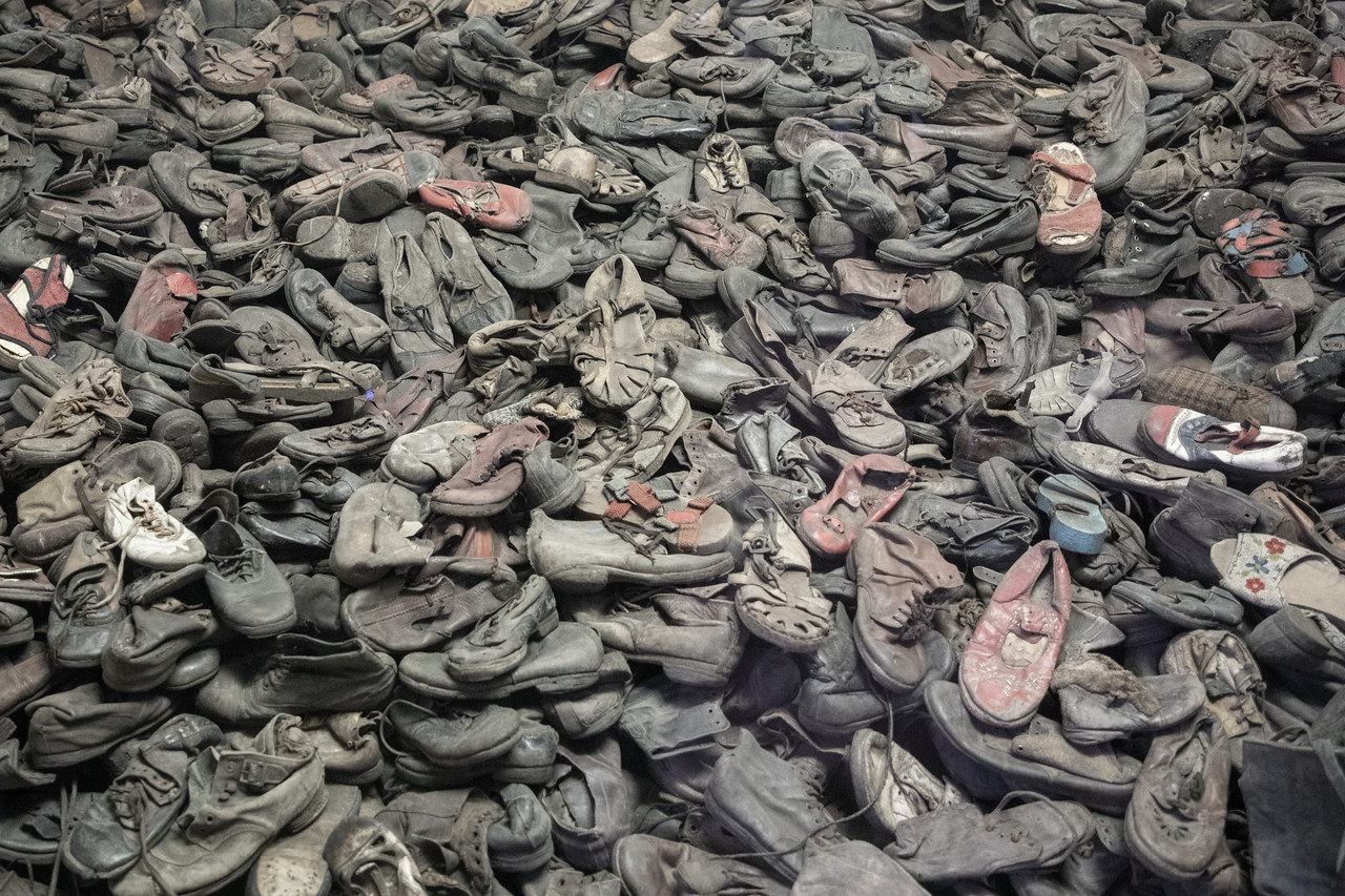 Large Pile Of Shoes Taken From The Inmates