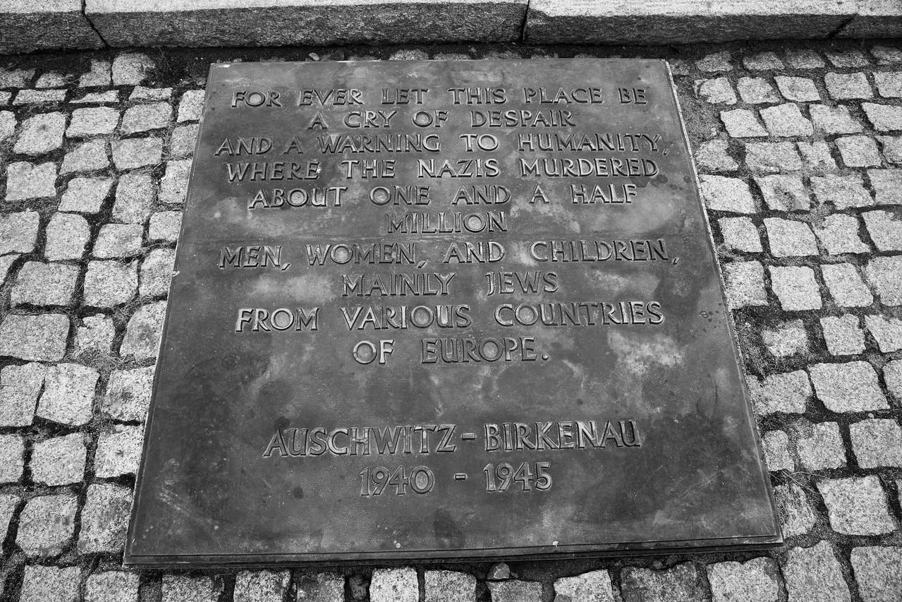 English Inscription On Granite Slab At The International Monument At Auschwitz