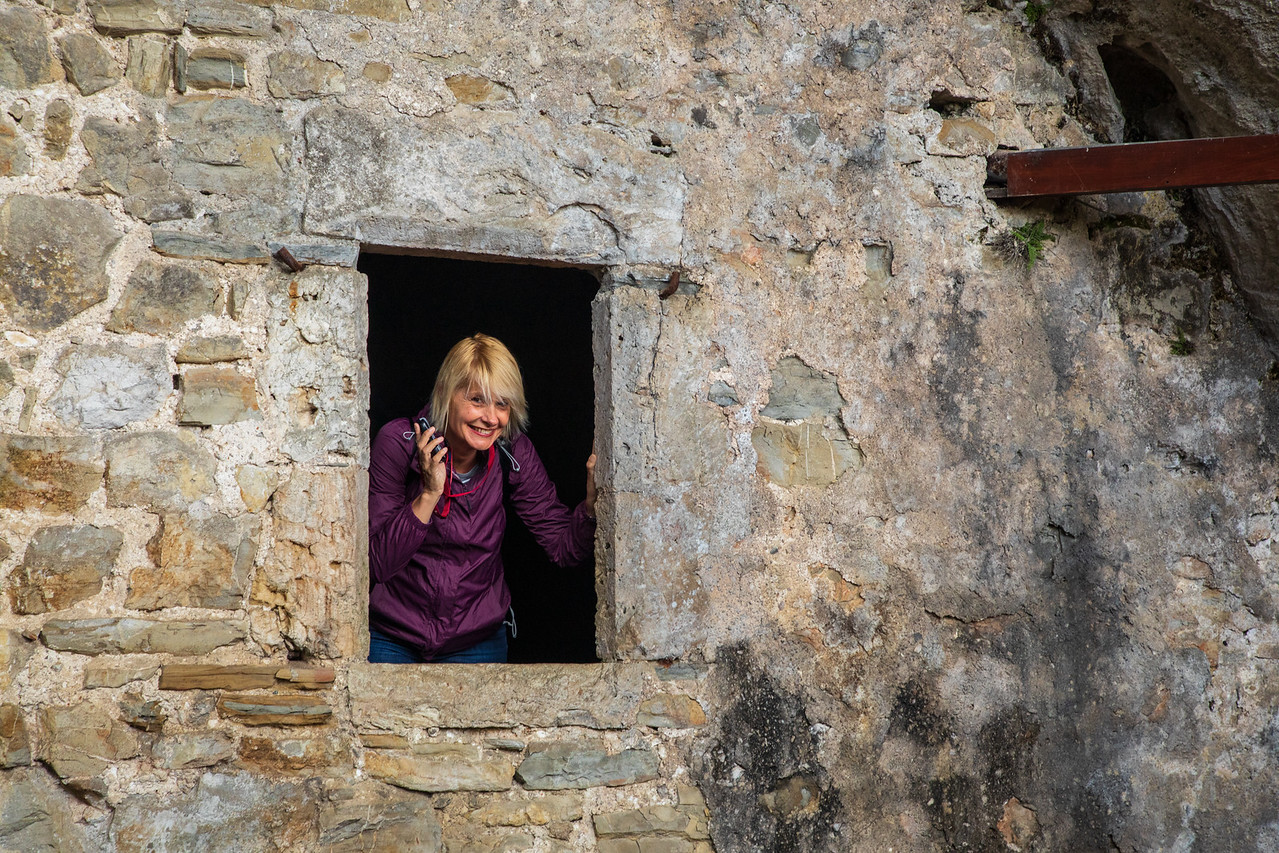 Sarah Looking Through a Window at Predjama Castle