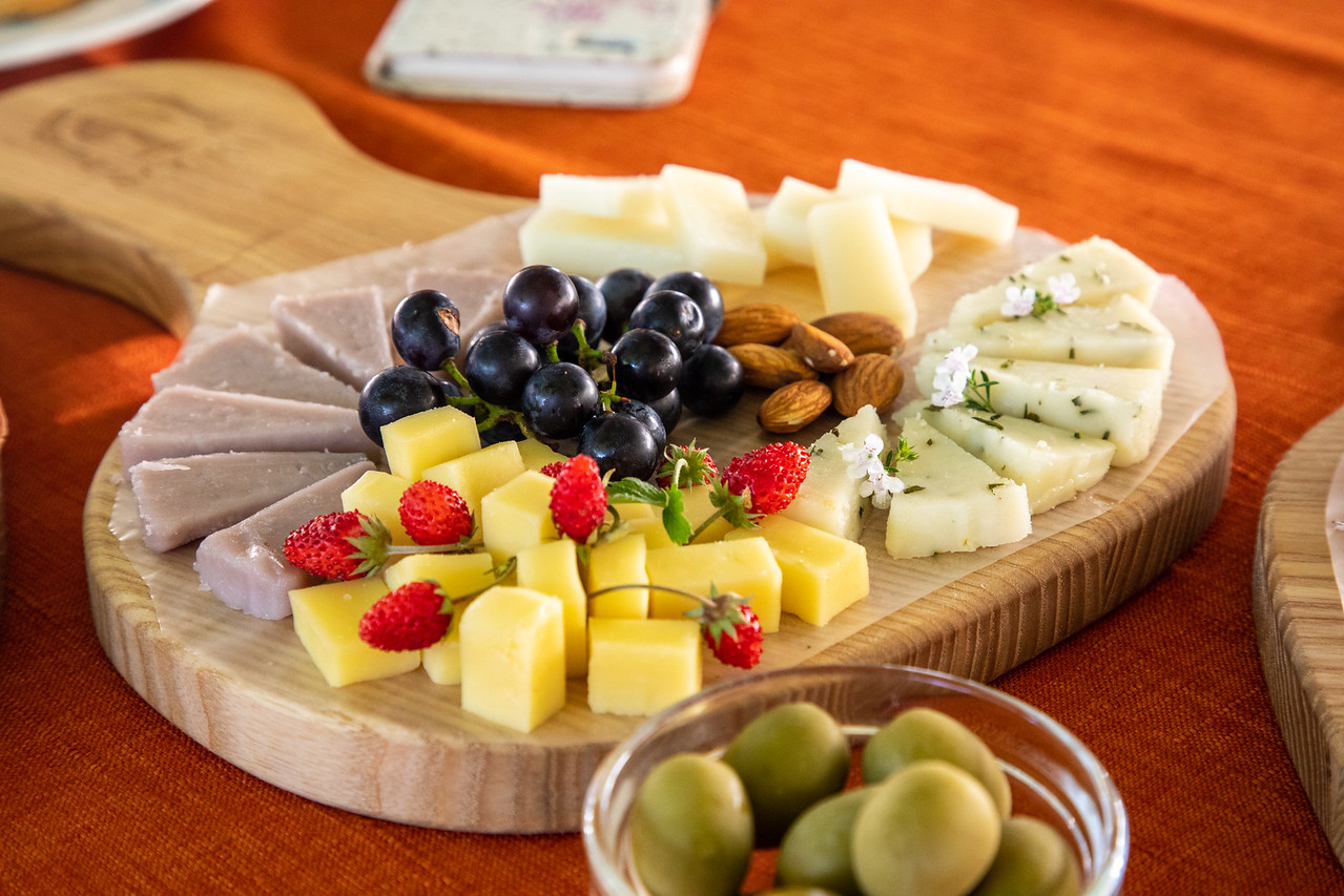 Locally Sourced Cheese Platter with Olives and Wild Strawberries