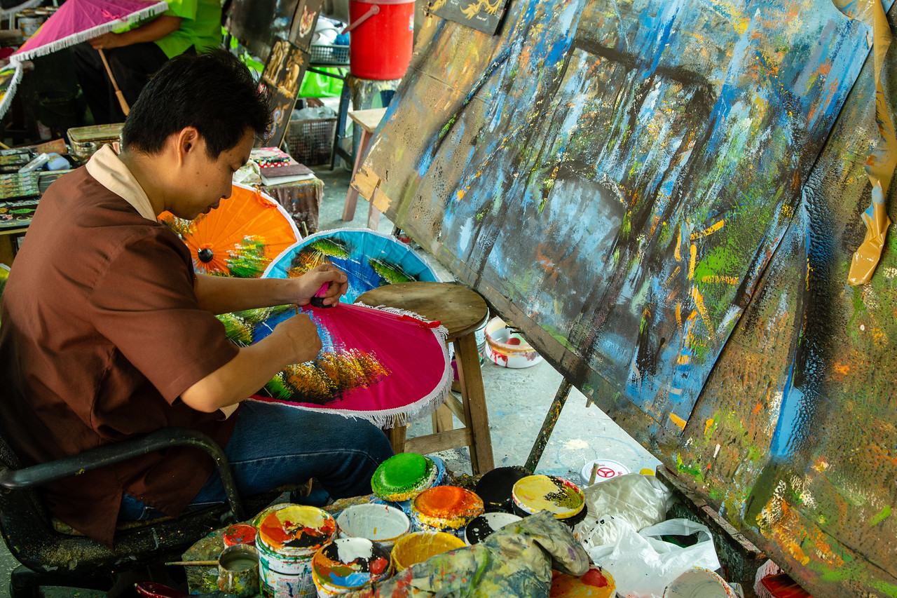 Man Painting an Umbrella at Bo Sang Umbrella Village Near Chiang Mai Thailand