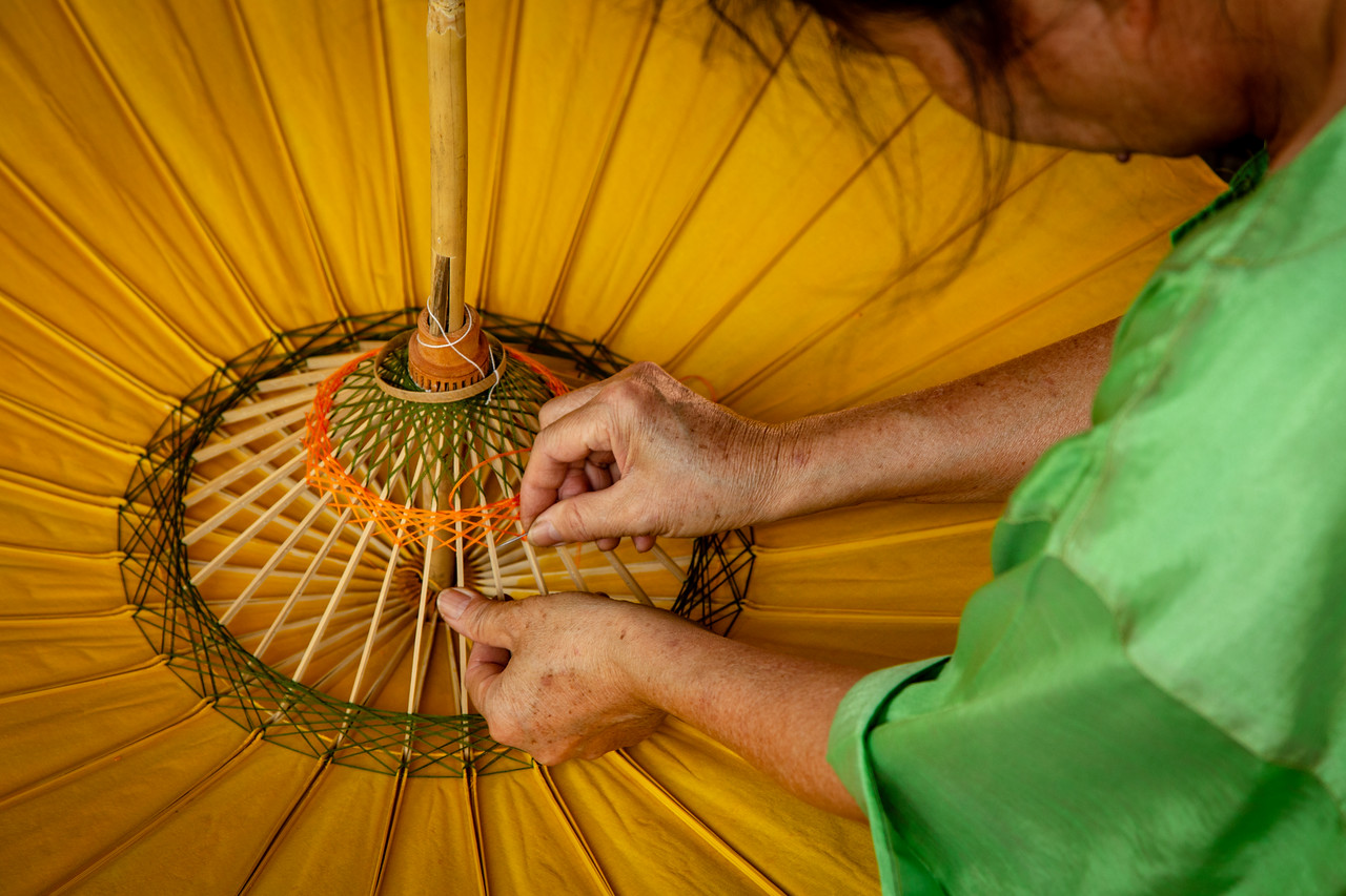 Woman Creating an Umbrella at Bo Sang Umbrella Village