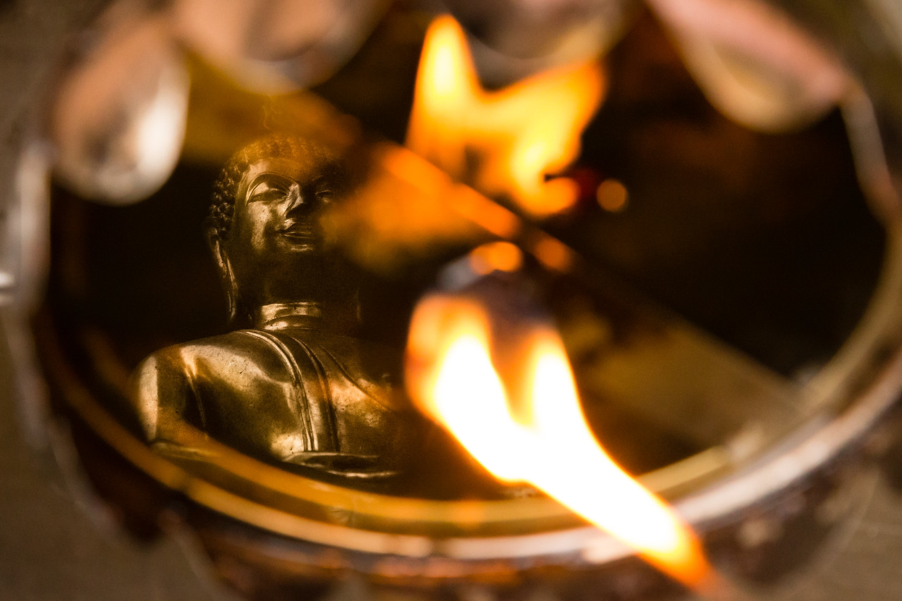Reflection of the Buddha in an Oil Candle