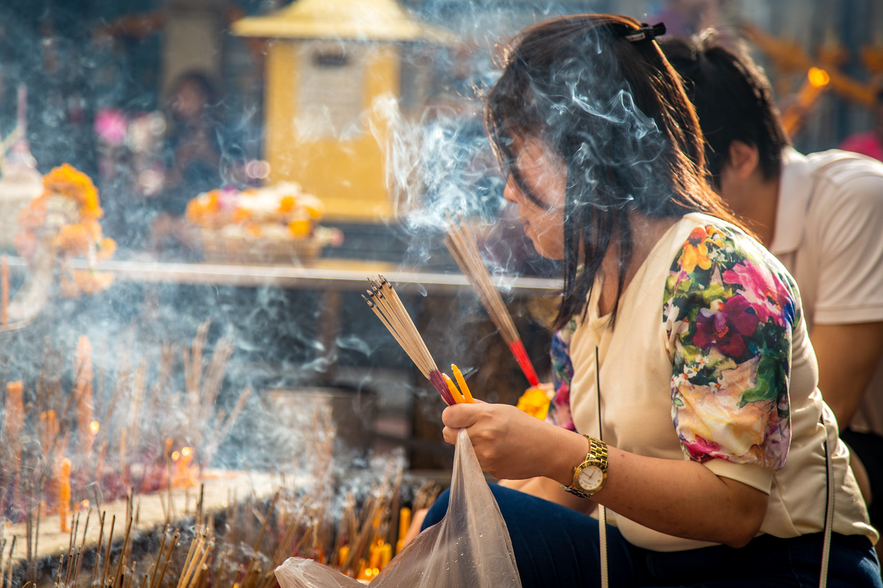 Worshiper Laying Flowers at Erawan Shrine