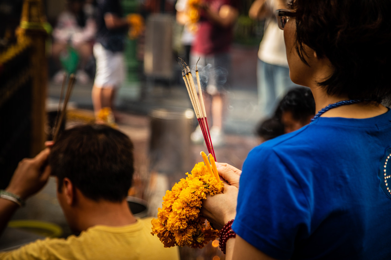 A Woman with Incense at the Erawan Shrine