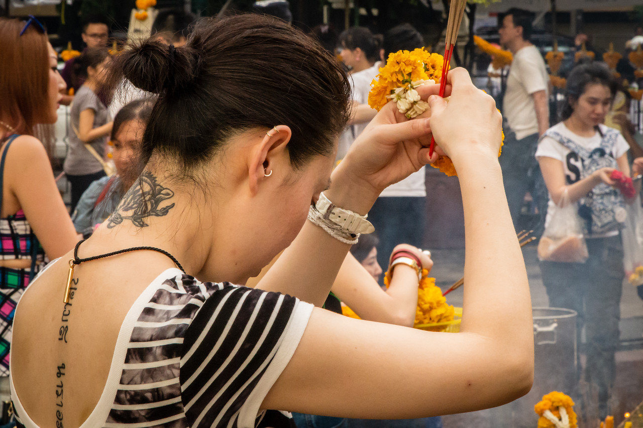 Worshiper Giving Reverence to Than Tao Mahaprom at Erawan Shrine
