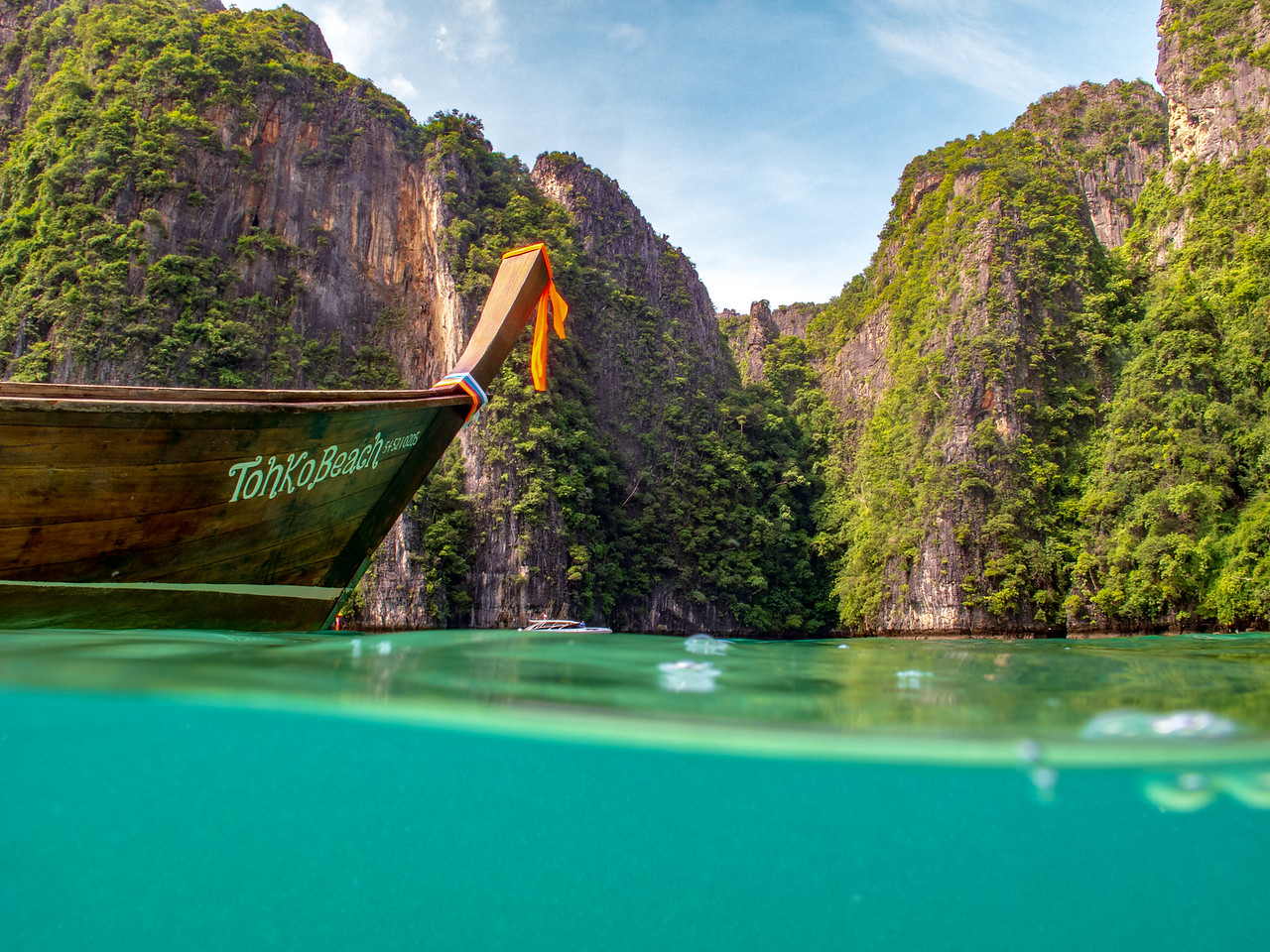 Longtail boat sit in the quiet waters of the Phi Phi Islands