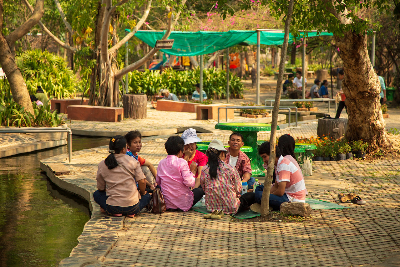Families Enjoying a Picnic at San Kamphaeng Hot Springs