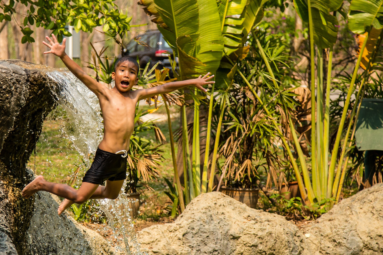 Kid Jumping in the Water at San Kamphaeng Hot Springs