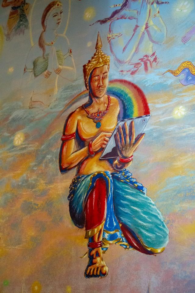 Buddha on an iPad in Wat Ban Rai Elephant Temple Thailand