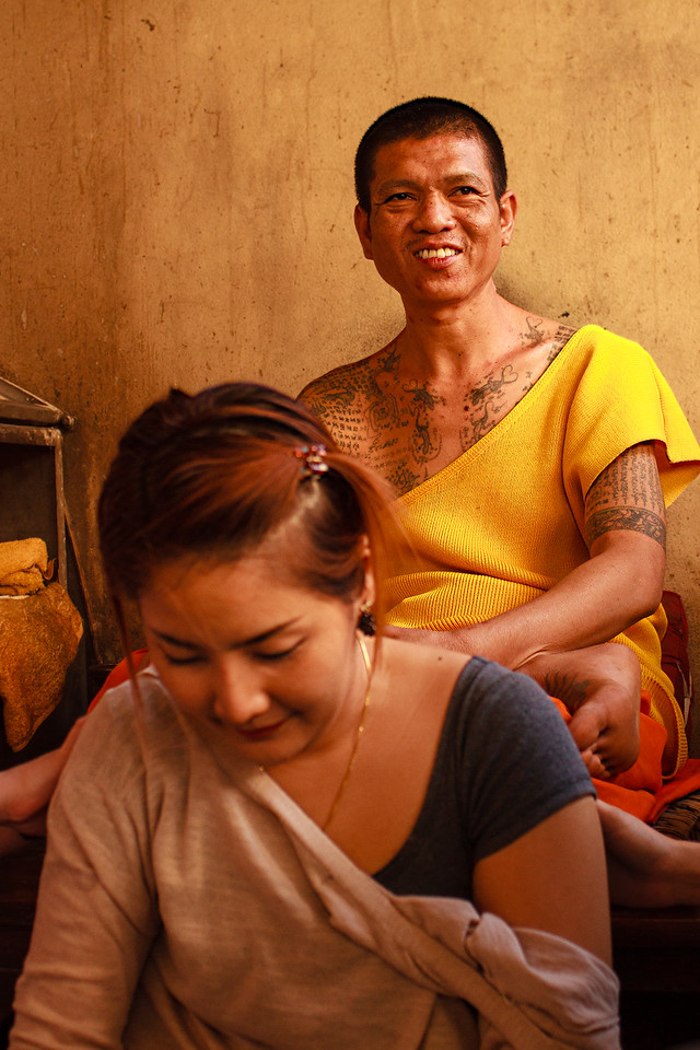 Woman Getting a Sak Yant Tattoo at Wat Bang Phra