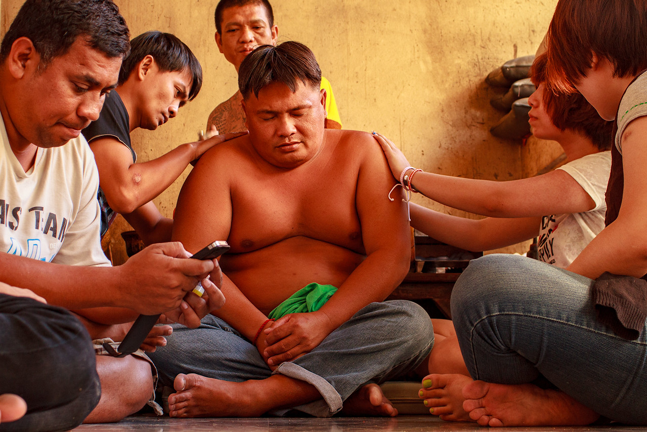 Man Getting a Sak Yant Tattoo at Wat Bang Phra Tattoo Temple