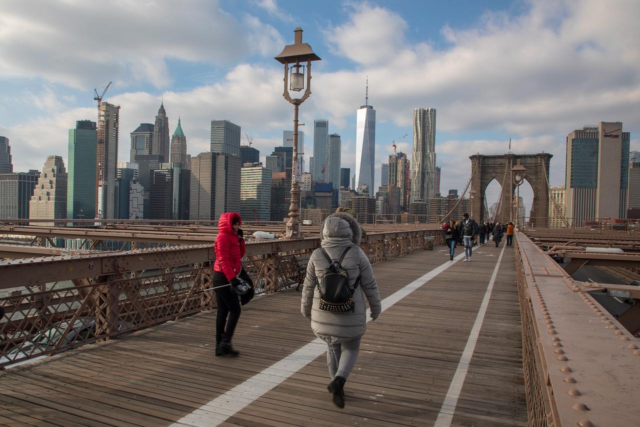 New York Skyline Walking on Brooklyn Bridge Picture