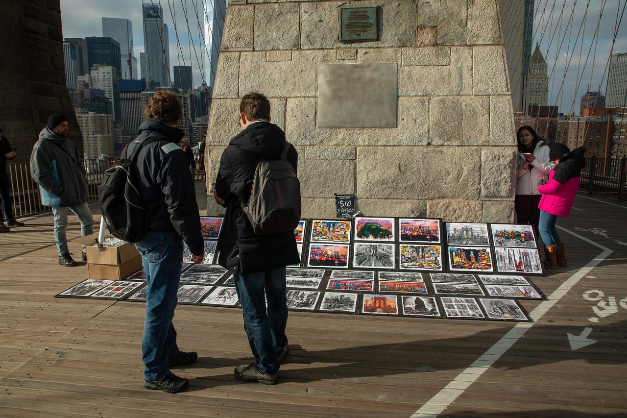 Artist Displaying Paintings On Brooklyn Bridge