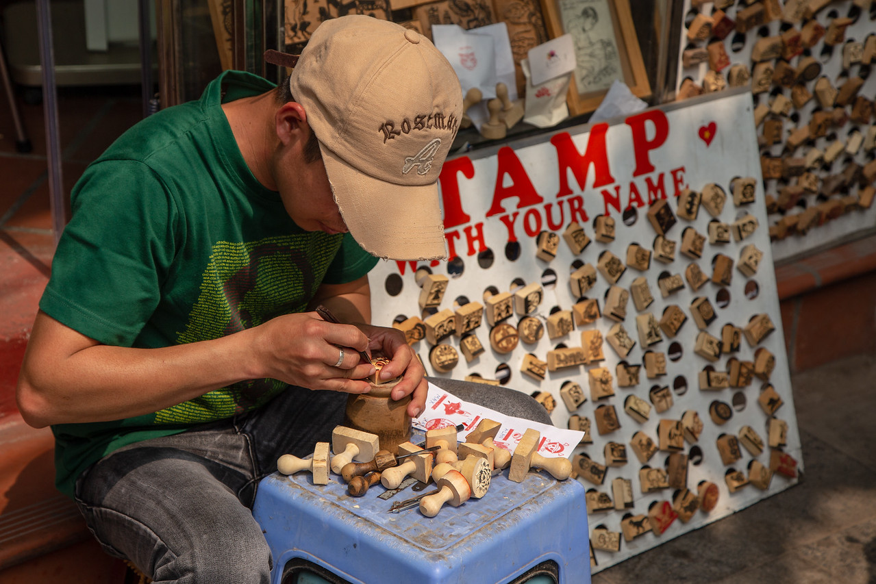 A Man Carves Personalized Stamps from Wood for Tourists