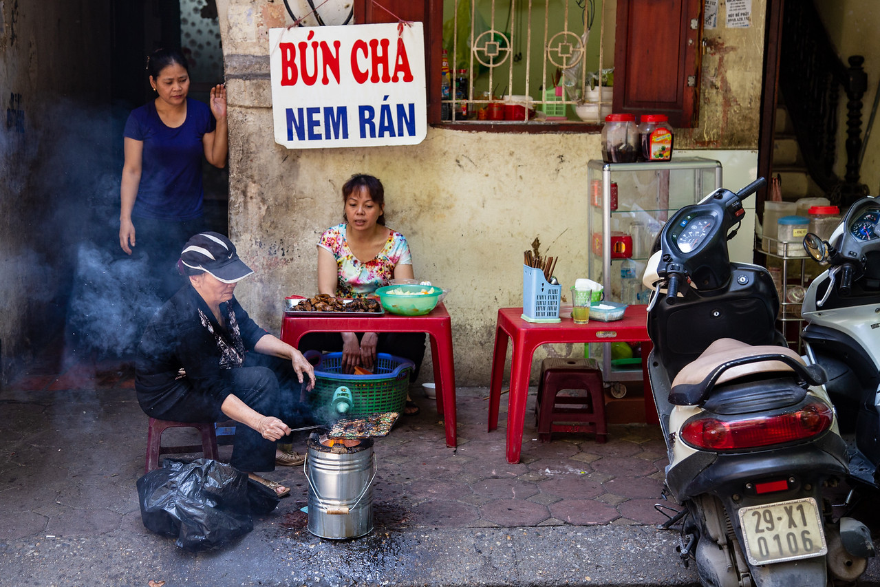A Woman Makes Bun Cha at Her Street Stand