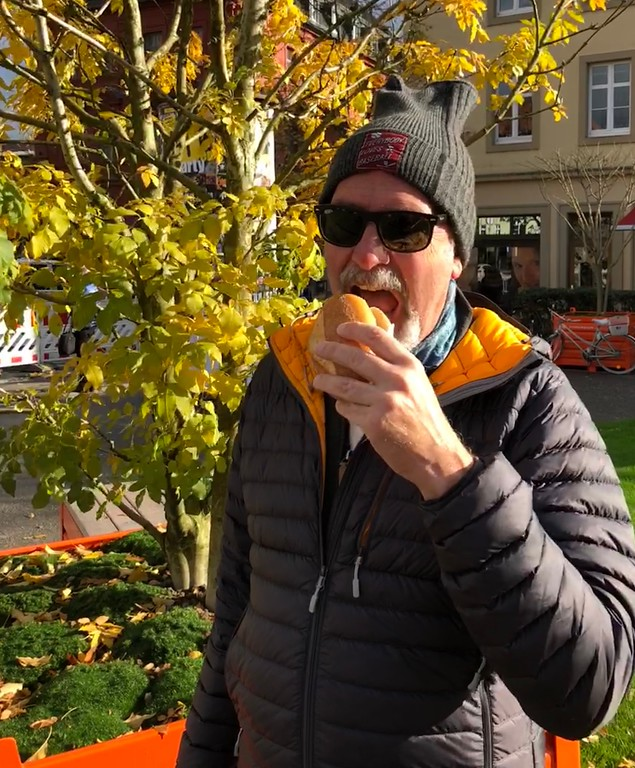 Jon Enjoying a Delicious Bratwurst