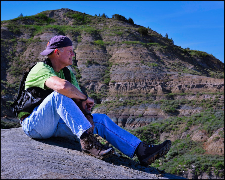 Sitting atop and rock in Theodore Roosevelt National Park, Medora, ND.