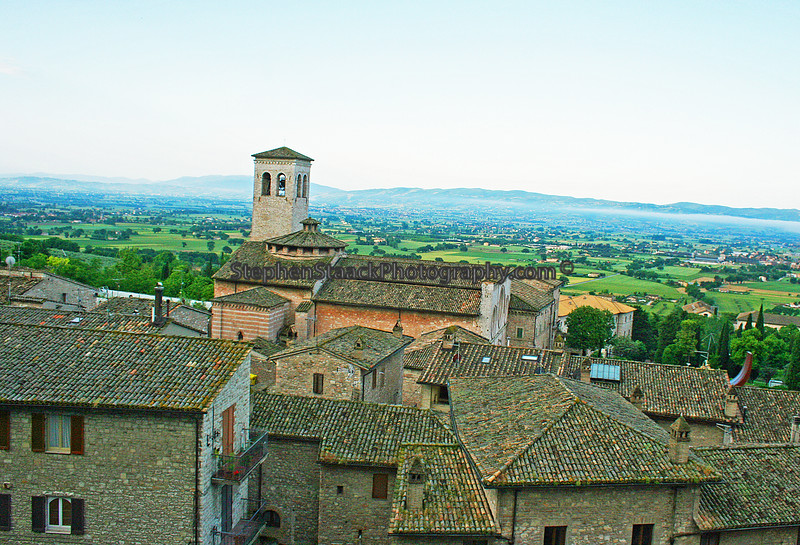A view from a hillside in Assisi, Italy with a church in the background.