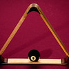 Chuck Knowles - Eight Ball placed within a triangle rack on a pool table