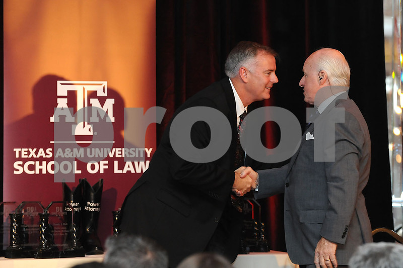 PWR ATTY 2013<br /> US District Judge Reed O'Conner shakes hands with Business Press owner Richard Conner after giving his speech.